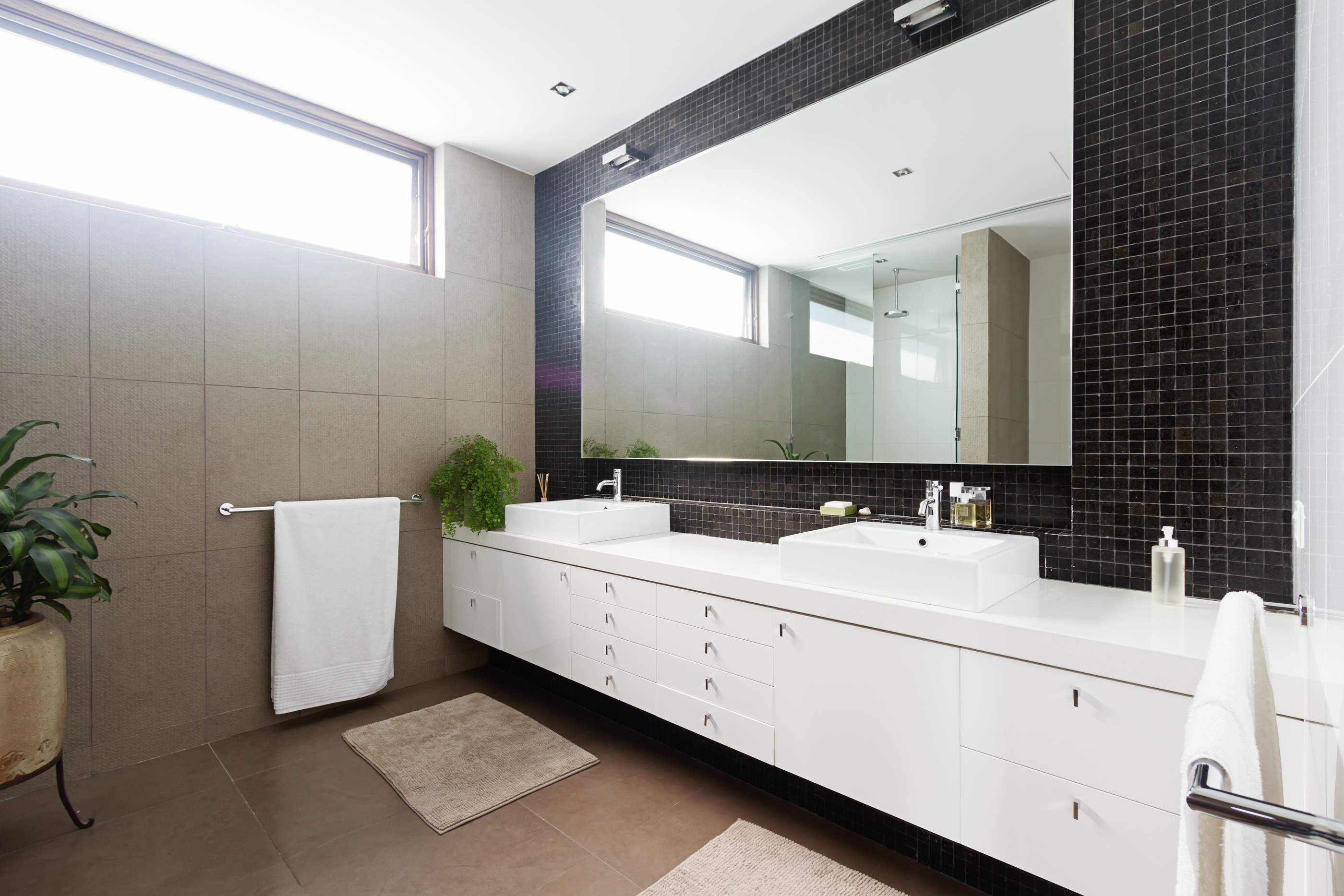 Black Mosaic Tiled Splashback And Double Basin Bathroom